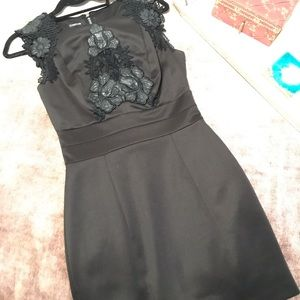 Bebe black Dress with Faux Leather Flower Details